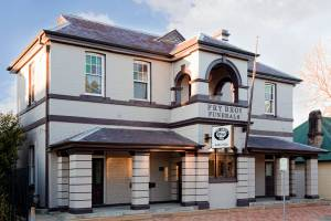 Fry Bros Raymond Terrace building location, outside. Cream, historic building with brown roofs.
