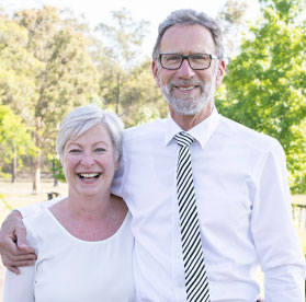 Happy protrait image of Tony and Margaret Fry the current owners of fry bros funerals